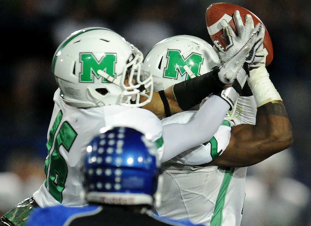 . Monrovia\'s Kurt Scoby (2) catches a pass over teammate Jordan Nathan (16) and runs for a touchdown against San Marino in the first half of a prep football game at Monrovia High School in Monrovia, Calif., on Friday, Nov. 8, 2013.    (Keith Birmingham Pasadena Star-News)