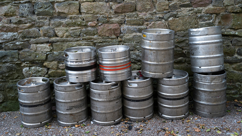 Beer barrels in front of stone wall, Newport, County Mayo, Republic of Ireland