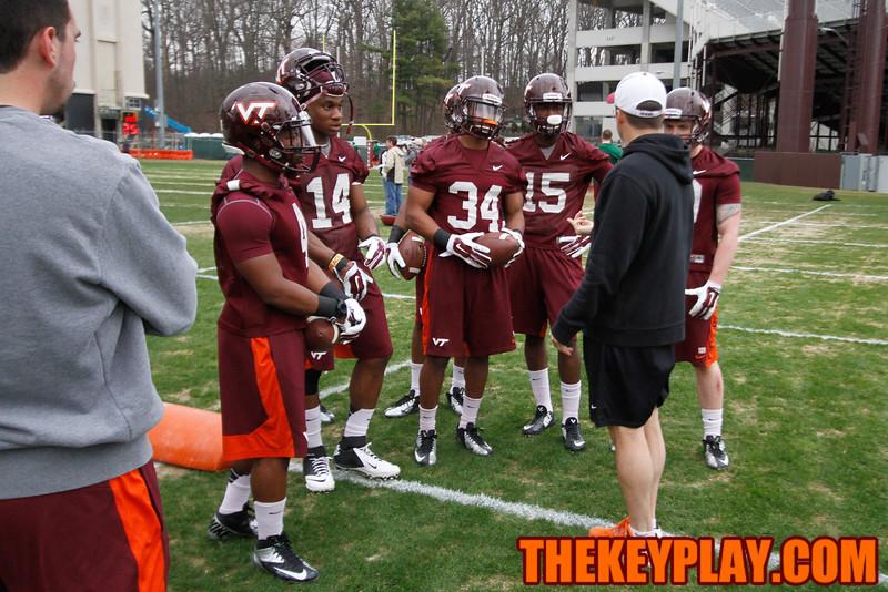 Assistant Coach Shane Beamer talks to the runningbacks before a set of drills. (Mark Umansky/TheKeyPlay.com)
