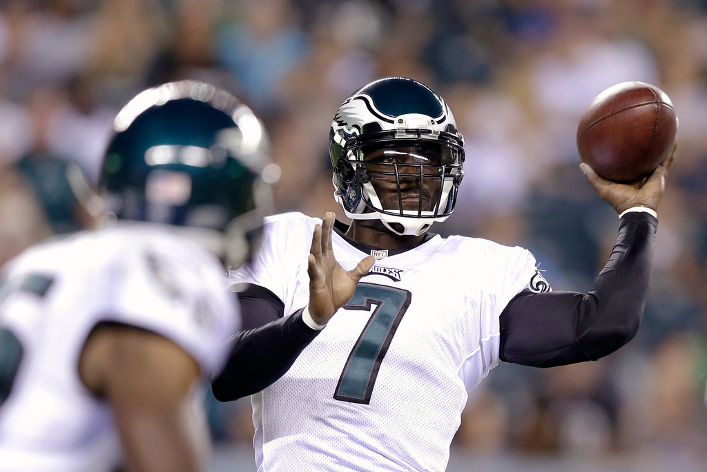 . Philadelphia Eagles\' Michael Vick passes during the first half of a preseason NFL football game against the Carolina Panthers, Thursday, Aug. 15, 2013, in Philadelphia. (AP Photo/Matt Rourke)