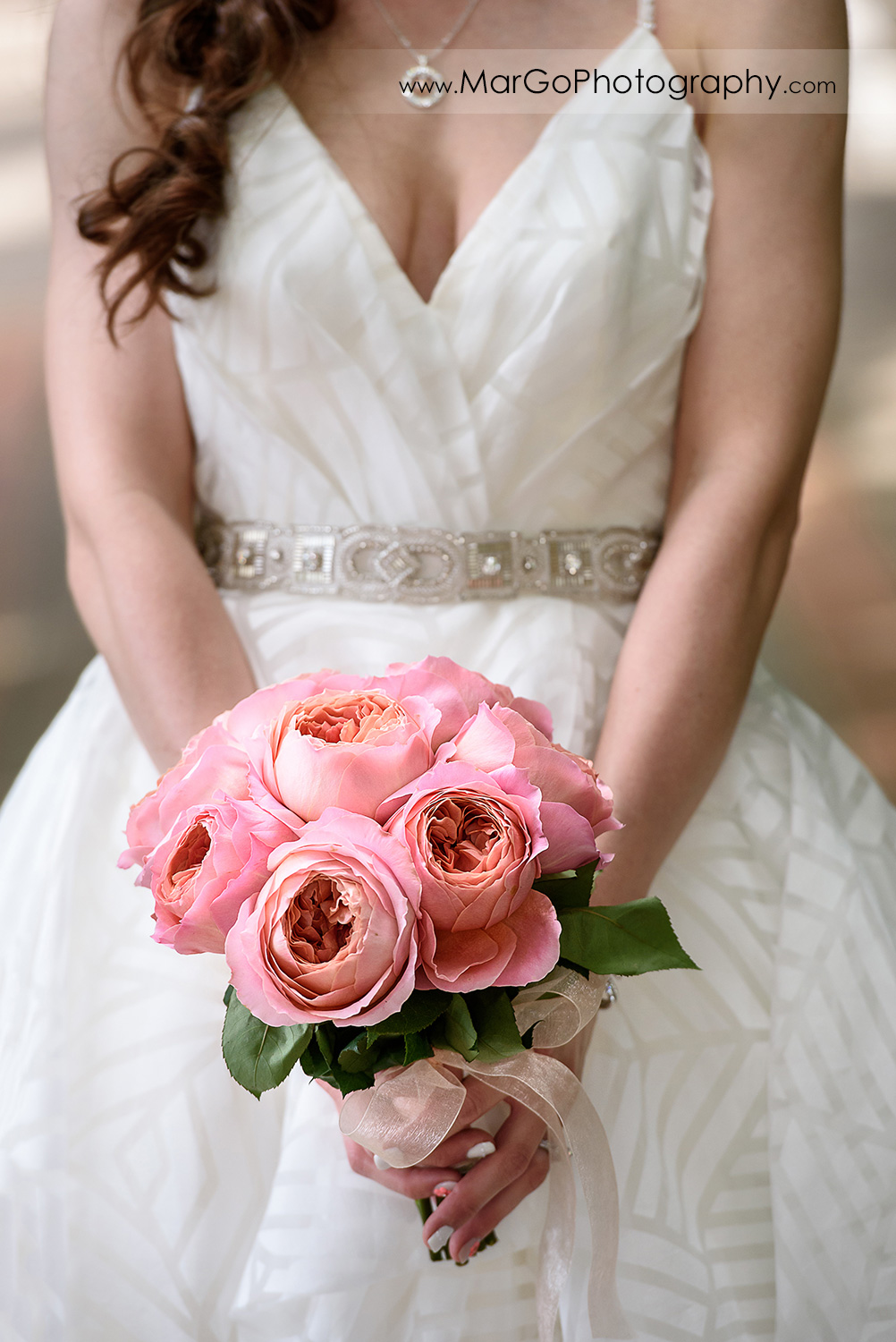 pink flower wedding bouquet in bride's hands at Saratoga Foothill Club