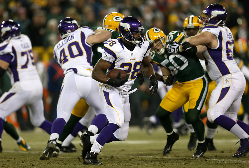 . Running back Adrian Peterson #28 of the Minnesota Vikings runs the ball in the first quarter against the Green Bay Packers during the NFC Wild Card Playoff game at Lambeau Field on January 5, 2013 in Green Bay, Wisconsin.  (Photo by Jonathan Daniel/Getty Images)