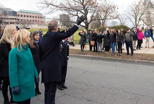 01/09/19 Wesley Bunnell | Staff Governor Ned Lamont waves to the well wishers who lined the parade route from the State Armory.