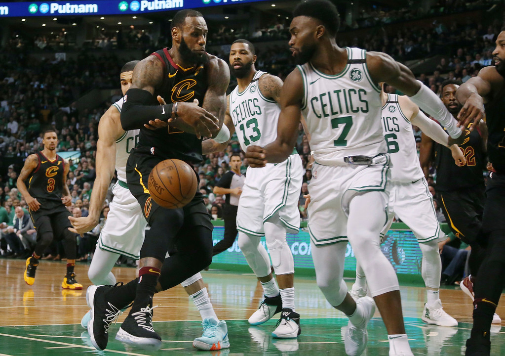 . Cleveland Cavaliers forward LeBron James, front left, loses control of the ball as he drives in front of Boston Celtics guard Jaylen Brown (7) during the first half in Game 7 of the NBA basketball Eastern Conference finals, Sunday, May 27, 2018, in Boston. (AP Photo/Elise Amendola)
