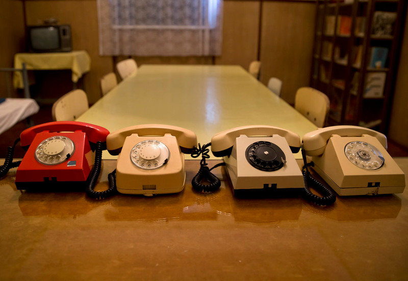 . A picture taken on Dec. 15, 2014 shows telephones, including the infamous red one, the direct line to the higher ranking communist authorities, in the commander\'s office, at the military garrison, turned museum, in Targoviste, Romania, where Romanian communist dictator Nicolae Ceausescu and his wife Elena spent their final days before being executed on Dec. 25, 1989. Romanians, especially those of a more senior age, have mixed feelings about the former dictator and his rule, 25 years after his execution, with many remembering predominantly the positive aspects, like the social security, of the communist times and not focusing on the extreme economic hardships and lack of basic human rights of that period, like freedom of movement or speech.(AP Photo/Vadim Ghirda)