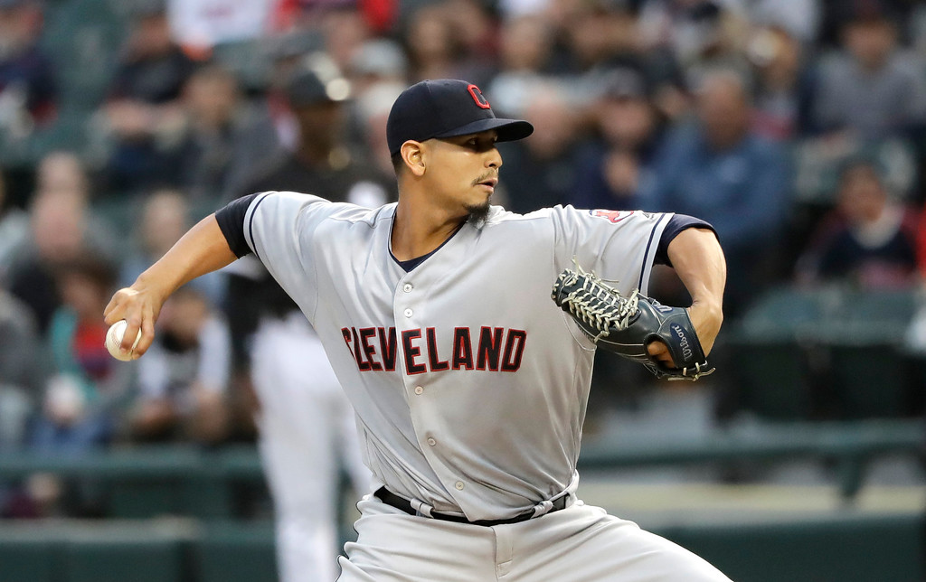 . Cleveland Indians starting pitcher Carlos Carrasco delivers during the first inning of a baseball game against the Chicago White Sox Monday, June 11, 2018, in Chicago. (AP Photo/Charles Rex Arbogast)