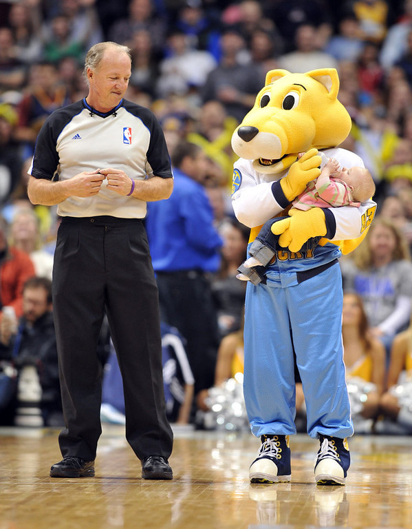 . DENVER, CO. - FEBRUARY 01: Denver Nuggets mascot Rocky, right, takes care of a young fan during the 2nd half of the game against New Orleans Hornets  on February 1, 2013 at the Pepsi Center in Denver, Colorado. Denver won 113-98. (Photo By Hyoung Chang/The Denver Post)