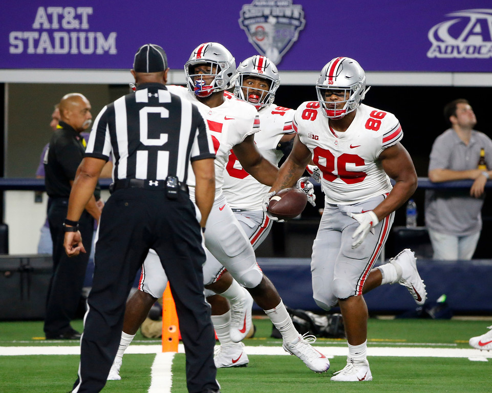 . Ohio State defensive tackle Dre\'Mont Jones (86) scores a touchdown on an interception of TCU during the second half of an NCAA college football game in Arlington, Texas, Saturday, Sept. 15, 2018. (AP Photo/Michael Ainsworth)