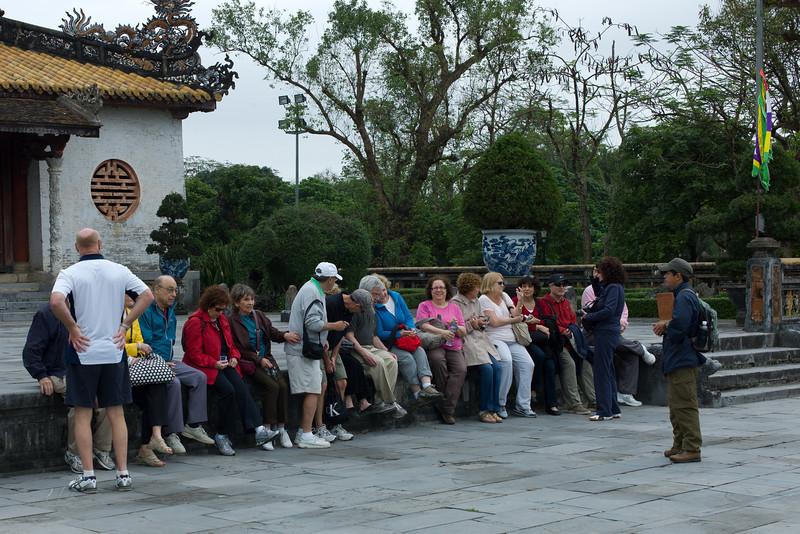Our Tauck Tour group at Hue Citadel / Imperial City, Hue, Vietnam.  Joe Van De Water (right shoulder and arm only(, Arnie Kaston (with back to camera), Kitty Walker (left shoulder, Jerry Kasoff, Linda Kasoff, Susan Rein, Burt Rein (standing), Mark Aronowitz (about to sit), Gerry Paul, Sherri Paul, Renee Mirsky, Lynn Kaston, Gretchen Lengyel, Susan Levin, Bruce Levin, Marti Minker (standing), David Minker (obscured).