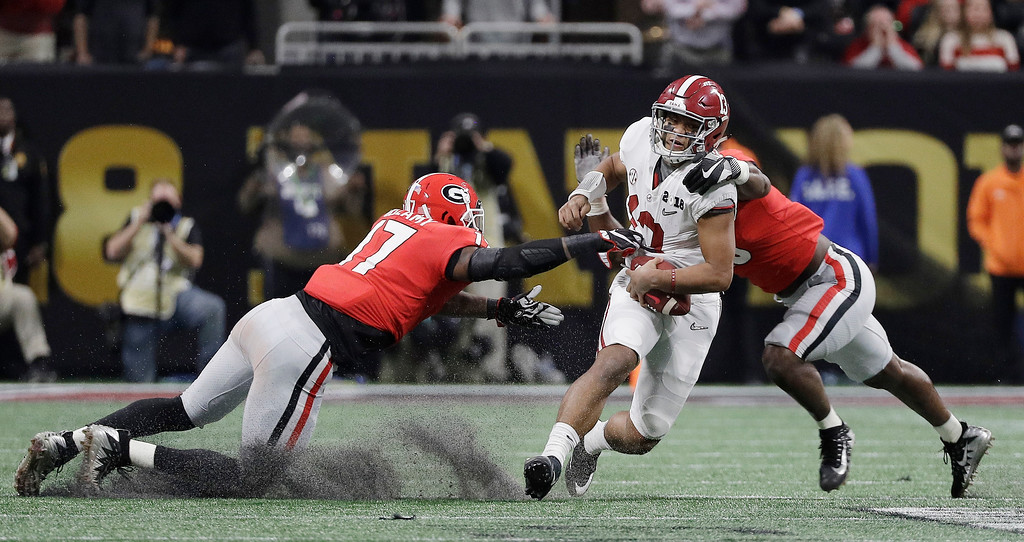 . Alabama quarterback Tua Tagovailoa runs for a first down during the second half of the NCAA college football playoff championship game against Georgia Monday, Jan. 8, 2018, in Atlanta. (AP Photo/David J. Phillip)