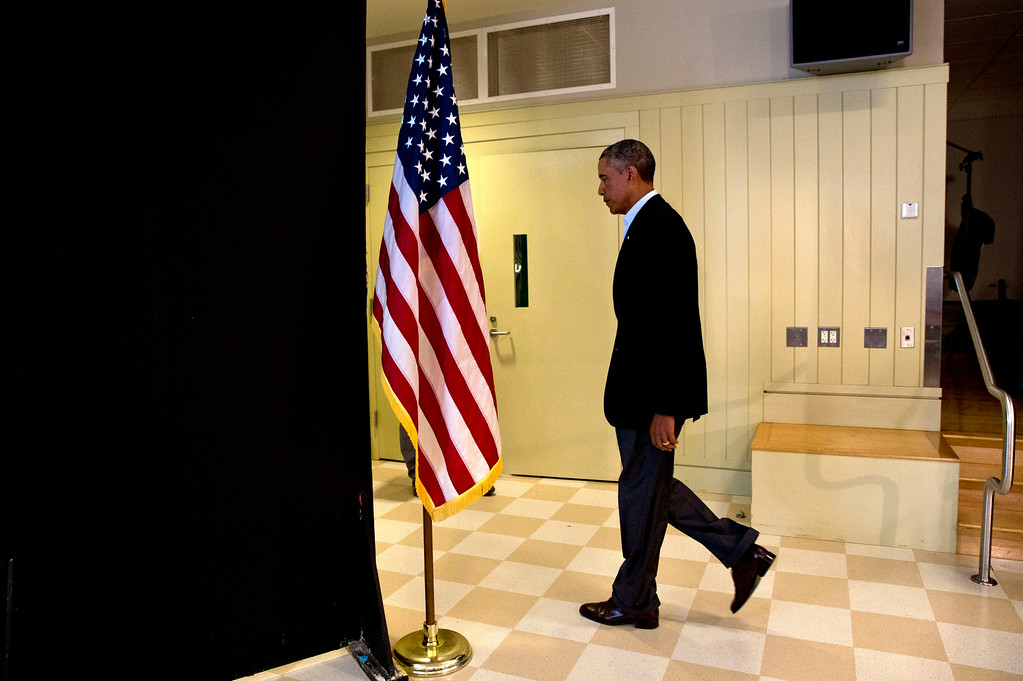""". President Barack Obama leaves after making statement about the killing of journalist James Foley in Syria, Wednesday, Aug. 20, 2014, in Edgartown, Mass.  The president said the US will continue to confront Islamic State extremists despite the brutal murder of journalist James Foley. Obama said the entire world is \""""appalled\"""" by Foley\'s killing. The president says he spoke Wednesday with Foley\'s family and offered condolences. (AP Photo/Jacquelyn Martin)"""