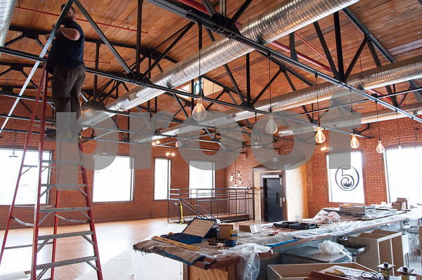 02/09/18 Wesley Bunnell   Staff Work continues on Friday afternoon at Five Churches Brewing at 193 Arch St in New Britain in anticipation of its grand opening that is yet to be determined. The front of the facility is shown with old style Edison style bulbs hanging above the bar.