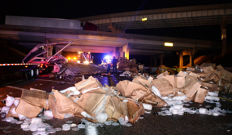 . A destroyed truck being blown off the 40 freeway is pictured with its damaged cargo after a tornado swept through Shawnee, in Oklahoma May 19, 2013. A massive storm front swept north through the central United States on Sunday, hammering the region with fist-sized hail, blinding rain and tornadoes, including a half-mile wide twister that struck near Oklahoma City. News reports said at least one person had died.  REUTERS/Gene Blevins