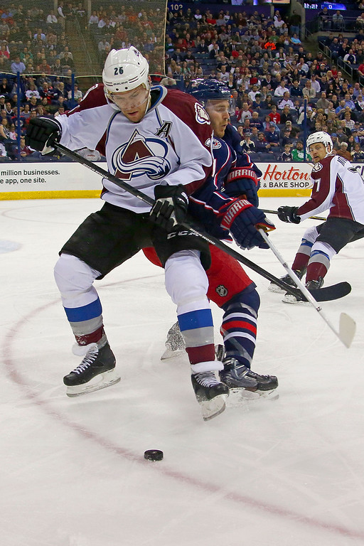 . COLUMBUS, OH - APRIL 1:  Paul Stastny #26 of the Colorado Avalanche and James Wisniewski #21 of the Columbus Blue Jackets battle for control of the puck during the first period on April 1, 2014 at Nationwide Arena in Columbus, Ohio. (Photo by Kirk Irwin/Getty Images)