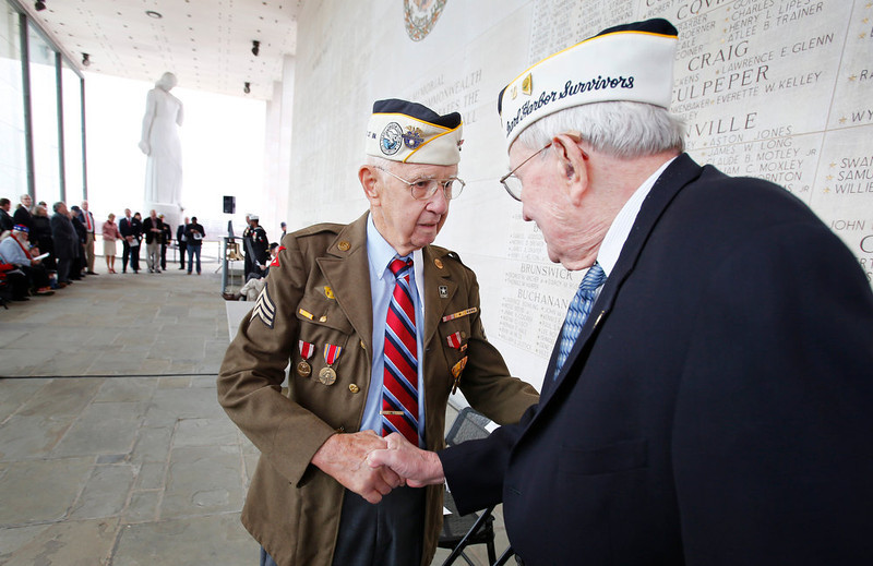 . Pearl Harbor survivors Max Green, left,  and Bill Thornton greet each other prior to the Pearl Harbor Day Remembrance Ceremony at the Va. War Memorial, in Richmond, Va. on Friday, Dec. 7, 2012.  The ceremony remembers those Virginians who died during the Japanese attack on Pearl Harbor, Hawaii on December 7, 1941. (AP Photo/Richmond Times-Dispatch, Dean Hoffmeyer)