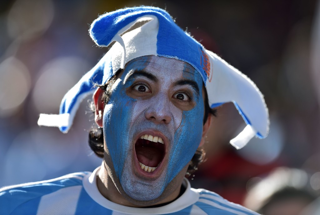 . An Argentina fan cheers prior to a Round of 16 football match between Argentina and Switzerland at Corinthians Arena in Sao Paulo during the 2014 FIFA World Cup on July 1, 2014.     AFP PHOTO / NELSON  ALMEIDA/AFP/Getty Images