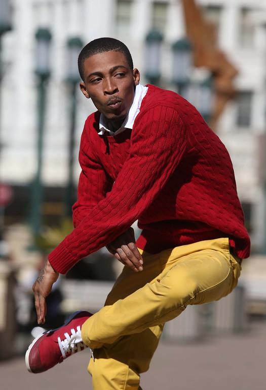 ". Turf Feinz member Darrell \""D-Real\"" Armstead does a turf dancing demonstration at Frank Ogawa Plaza in Oakland, Calif., on Friday, Feb. 22, 2013. (Jane Tyska/Staff)"