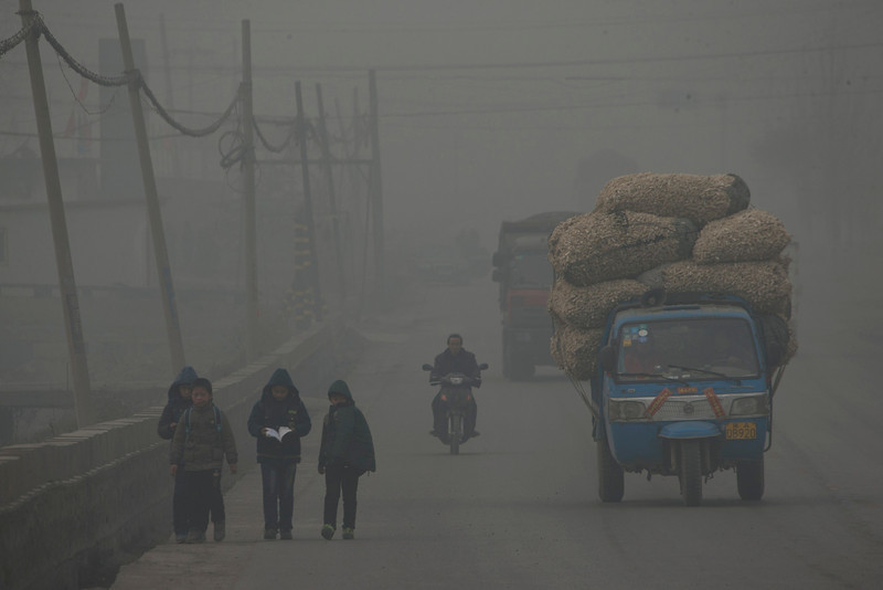 . Children walk back home after school on a severely polluted day in Shijiazhuang, in northern China\'s Hebei province, Wednesday, Feb. 26, 2014. (AP Photo/Alexander F. Yuan)