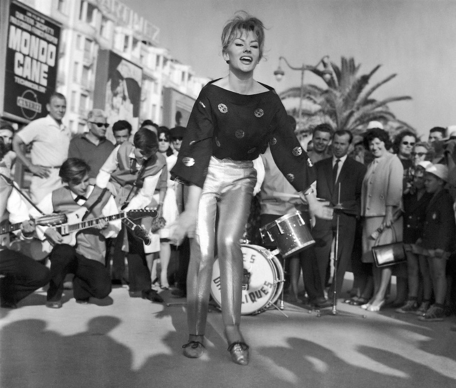 . Backed by a Rock�n�Roll group, Swedish mannequin Anny Nielsen, known was �Miss Angora�, attracts a crowd of onlookers as she lets go with the twist on the sea-front at Cannes in France on May 17, 1962, where the annual film festival is in progress. Anny lives in France. (AP Photo)