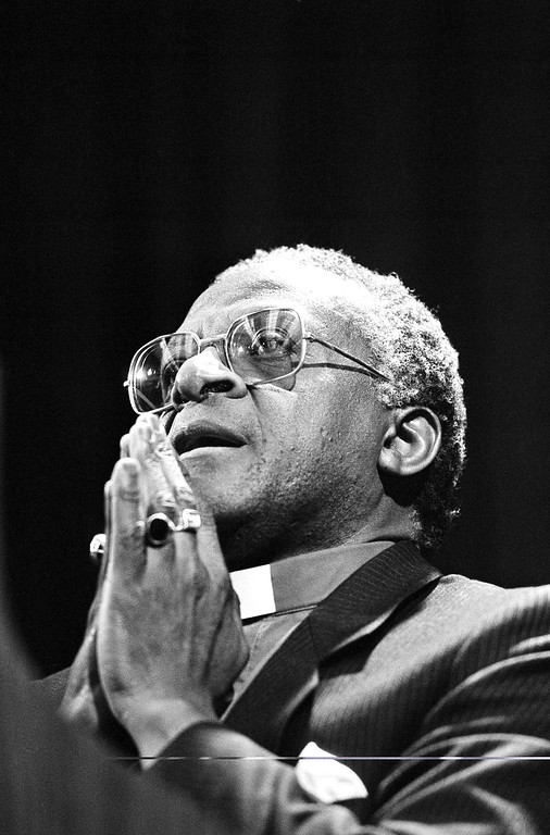 . Bishop Desmond Tutu of South Africa, holds his hands together during a speech at the University of California at San Diego, Jan. 23, 1986. (AP Photo/Ken Levine)