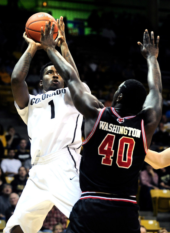 . University of Colorado\'s () against Arkansas State\'s during their game at the Coors Events Center on the CU Boulder Campus in Boulder, Colorado on November 18, 2013.  Photo by Paul Aiken / The Boulder Daily Camera.