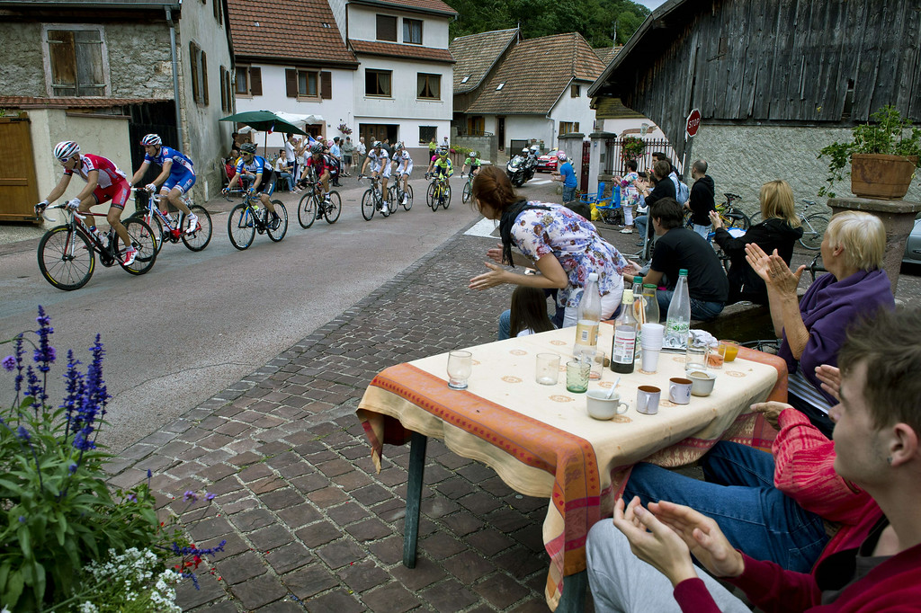 . Cyclists ride as supporters cheer during the 170 km ninth stage of the 101st edition of the Tour de France cycling race on July 13, 2014 between Gerardmer and Mulhouse, eastern France.  AFP PHOTO / ERIC FEFERBERGERIC FEFERBERG/AFP/Getty Images