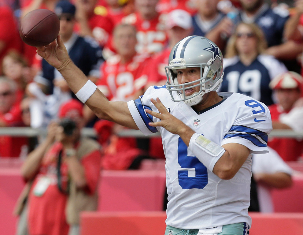. Dallas Cowboys quarterback Tony Romo (9) passes to a teammate during the first half of an NFL football game against the Kansas City Chiefs at Arrowhead Stadium in Kansas City, Mo., Sunday, Sept. 15, 2013. (AP Photo/Charlie Riedel)