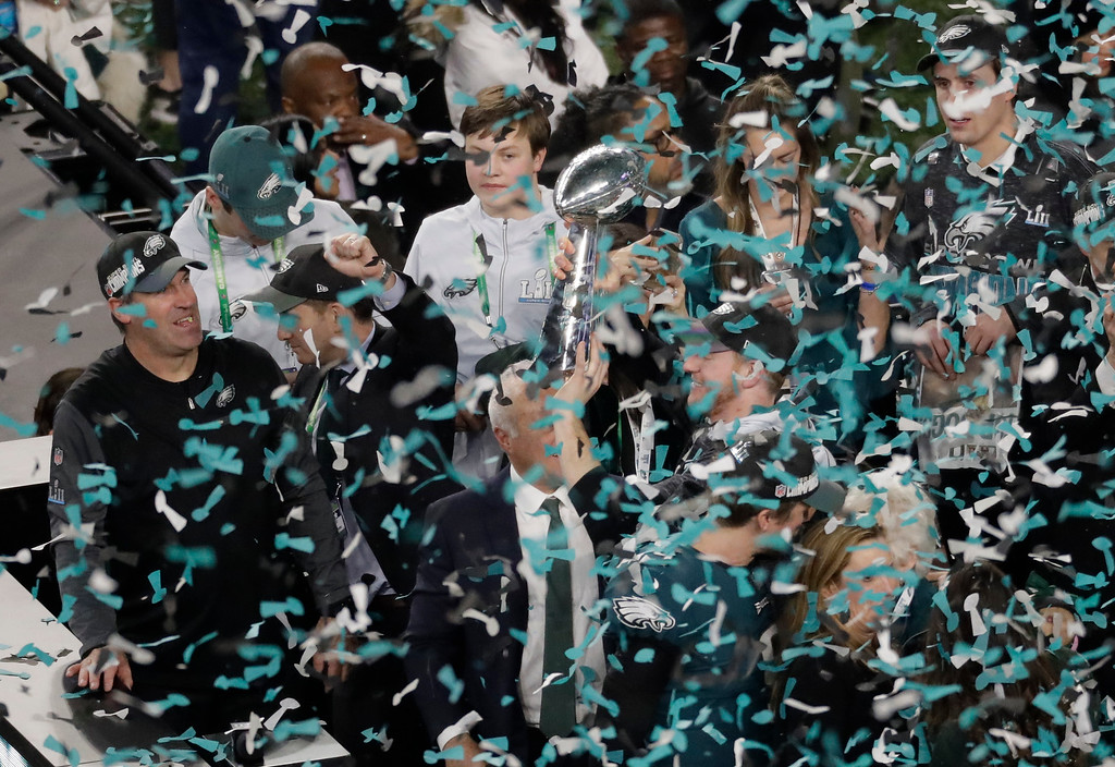 . Philadelphia Eagles quarterback Carson Wentz hoists the Vincent Lombardi trophy after the NFL Super Bowl 52 football game against the New England Patriots, Sunday, Feb. 4, 2018, in Minneapolis. The Eagles won 41-33. (AP Photo/Eric Gay)
