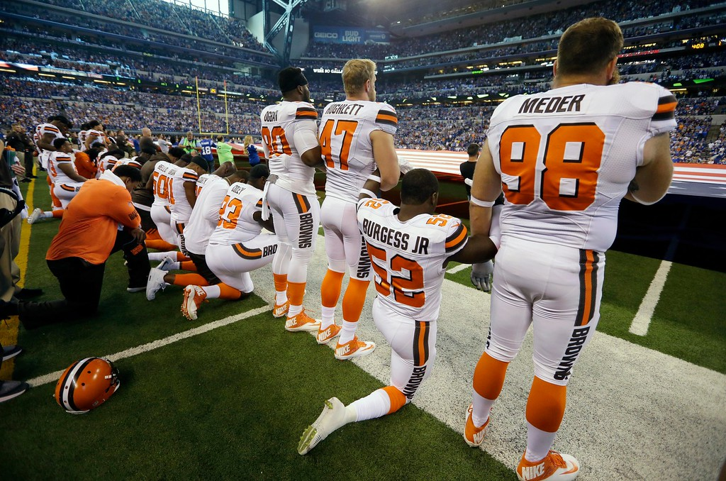 . Members of the Cleveland Browns take a knee during the national anthem before an NFL football game against the Indianapolis Colts in Indianapolis, Sunday, Sept. 24, 2017. (AP Photo/Michael Conroy)
