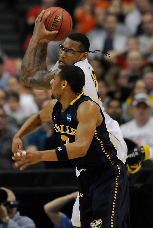 . Wichita #22 Carl Hall takes a rebound away from Wichita #3 Evan Wessel in the first half. La Salle played Wichita State at Staples Center for the West Regional of the NCAA Division I Men\'s Basketball Championships. Los Angeles,CA 3/28/2013(John McCoy/Staff Photographer