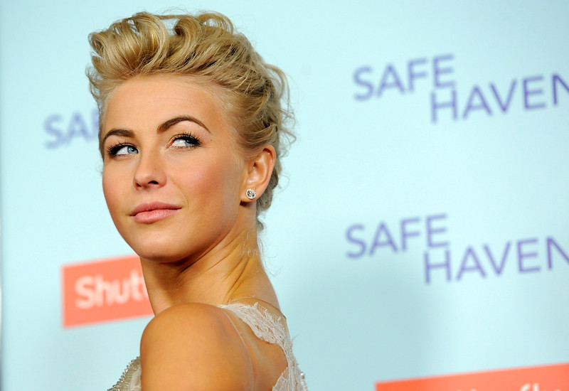 """. Julianne Hough, a cast member in \""""Safe Haven,\"""" turns back for photographers at the U.S. premiere of the film, Tuesday, Feb. 5, 2013, in the Hollywood section of Los Angeles. (Photo by Chris Pizzello/Invision/AP)"""