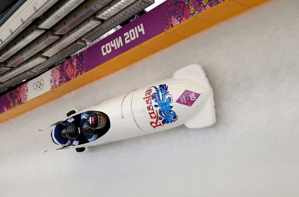 . The team from Russia RUS-2, with Alexander Kasjanov, Ilvir Huzin, Maxim Belugin and Aleksei Pushkarev, take a curve during the men\'s four-man bobsled competition final at the 2014 Winter Olympics, Sunday, Feb. 23, 2014, in Krasnaya Polyana, Russia. (AP Photo/Michael Sohn)