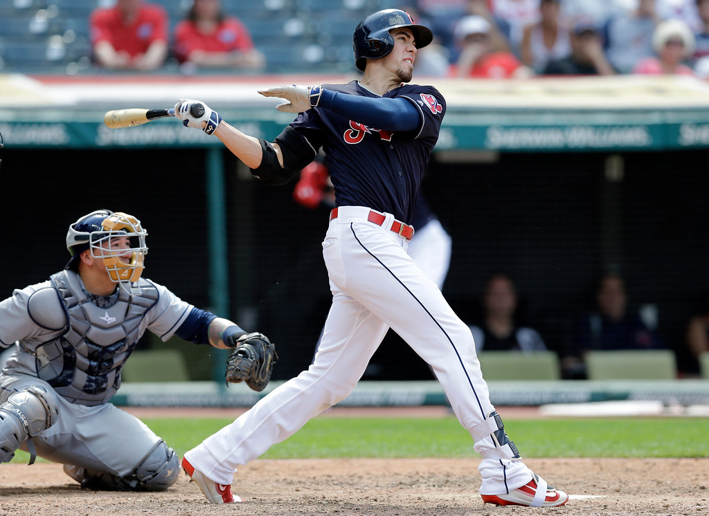 . Cleveland Indians\' Bradley Zimmer hits a solo home run off Tampa Bay Rays relief pitcher Alex Colome in the ninth inning of a baseball game, Wednesday, May 17, 2017, in Cleveland. Catcher Jesus Sucre watches. The Rays won 7-4. (AP Photo/Tony Dejak)