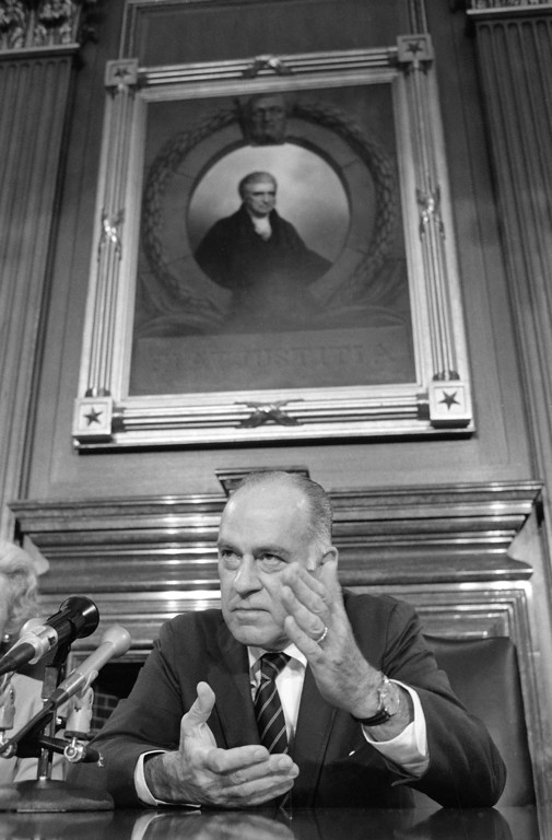 . Supreme Court Justice Potter Stewart speaks to reporters at a news conference in Washington where he discussed his decision to retire from court, June 20, 1981.  Stewart, who sits in front of a portrait of John Marshall who was chief justice from 1801 to 1835, said he was persuaded to retire by a letter fro a high school student.  (AP Photo/Bob Daugherty)