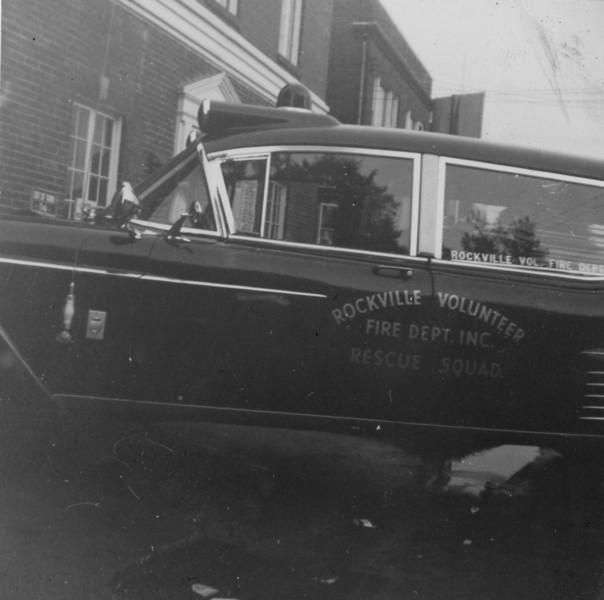 Archie Tolbert washing new ambulance