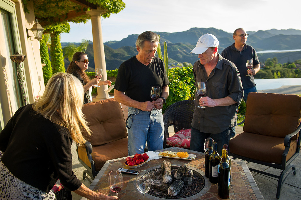 . Cellarmasters of Los Angeles members, from left, Carol Schreiber, Suzy Mandel Canter, Chet Schreiber, Andy Coradeschi and Jeff Canter sample their homemade wine at the Schreiber\'s Westlake home, Thursday, April 24, 2014. (Photo by Michael Owen Baker/L.A. Daily News)