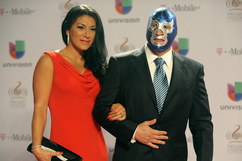 ". Blue Demon Jr. (R)arrives at the 25th Anniversary Of Univision\'s \""Premio Lo Nuestro A La Musica Latina\"" on February 21, 2013 in Miami, Florida.  (Photo by Gustavo Caballero/Getty Images for Univision)"