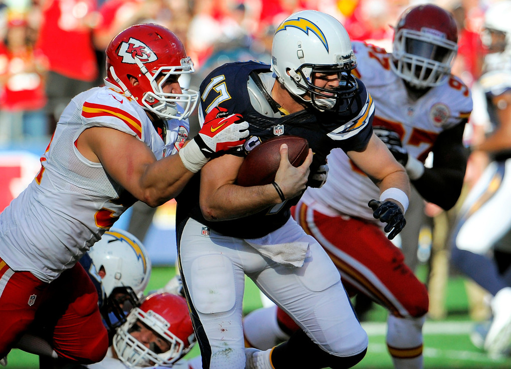 . San Diego Chargers quarterback Philip Rivers is hauled down for a sack by Kansas City Chiefs linebacker Frank Zombo, left, during the first half in an NFL football game, Sunday, Dec. 29, 2013, in San Diego. (AP Photo/Denis Poroy)