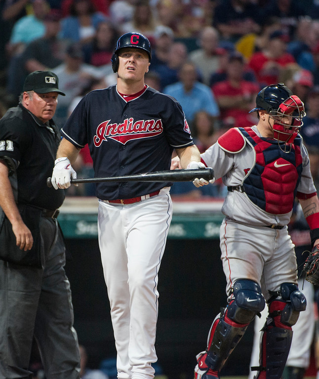 . Cleveland Indians\' Jay Bruce steps away from the plate as umpire Hunter Wendelstedt watches with Boston Red Sox\' Christian Vazquez during the fourth inning of a baseball game in Cleveland, Monday, Aug. 21, 2017. The Indians won 5-4. (AP Photo/Phil Long)