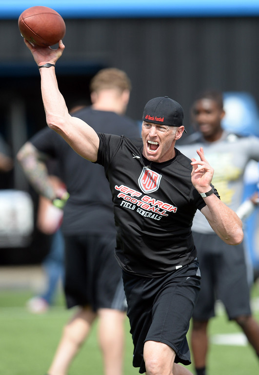 . Former NFL quarterback Jeff Garcia throws the ball during UCLA Football Pro Day at Spaulding Field on the UCLA campus Tuesday, March 11, 2014. (Photo by Hans Gutknecht/Los Angeles Daily News)