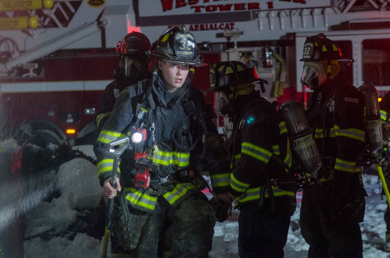 Westminster FF Dave Monty exits the building at a 2nd Alm on Hy Rd.