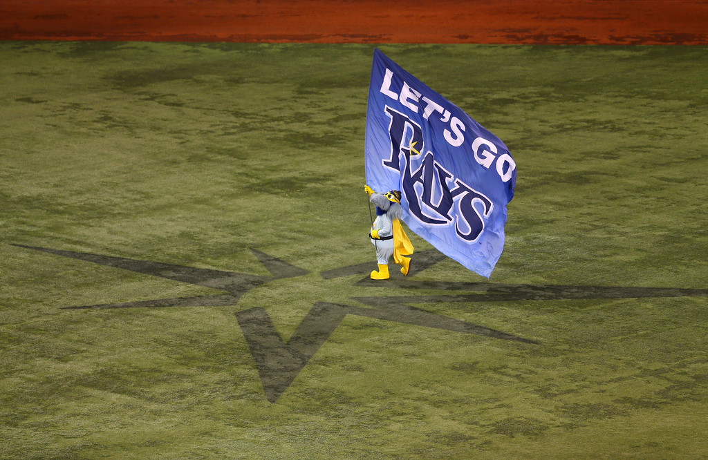 . Tampa Bay Rays mascot Raymond carries a flag in the outfield prior to Game Three of the American League Division Series against the Boston Red Sox at Tropicana Field on October 7, 2013 in St Petersburg, Florida.  (Photo by Mike Ehrmann/Getty Images)