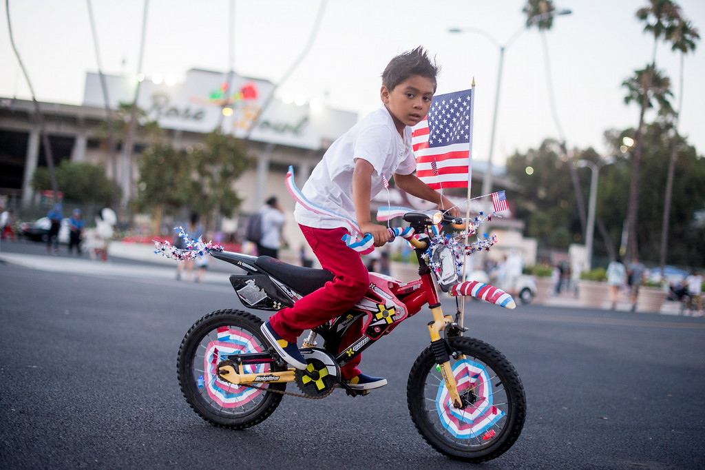 . Daniel Gomez, 6, of Whittier, rides around the Rose Bowl with his decorated bike during the 88th Annual Fourth of July Celebration, Americafest at the Rose Bowl in Pasadena Friday night, July 4, 2014. (Photo by Sarah Reingewirtz/Pasadena Star-News)