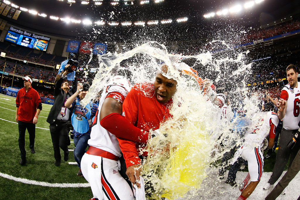 . The Gatorade bucket is dumped on head coach Charlie Strong of the Louisville Cardinals after their 33 to 23 win over the Florida Gators in the Allstate Sugar Bowl at Mercedes-Benz Superdome on January 2, 2013 in New Orleans, Louisiana.  (Photo by Chris Graythen/Getty Images)
