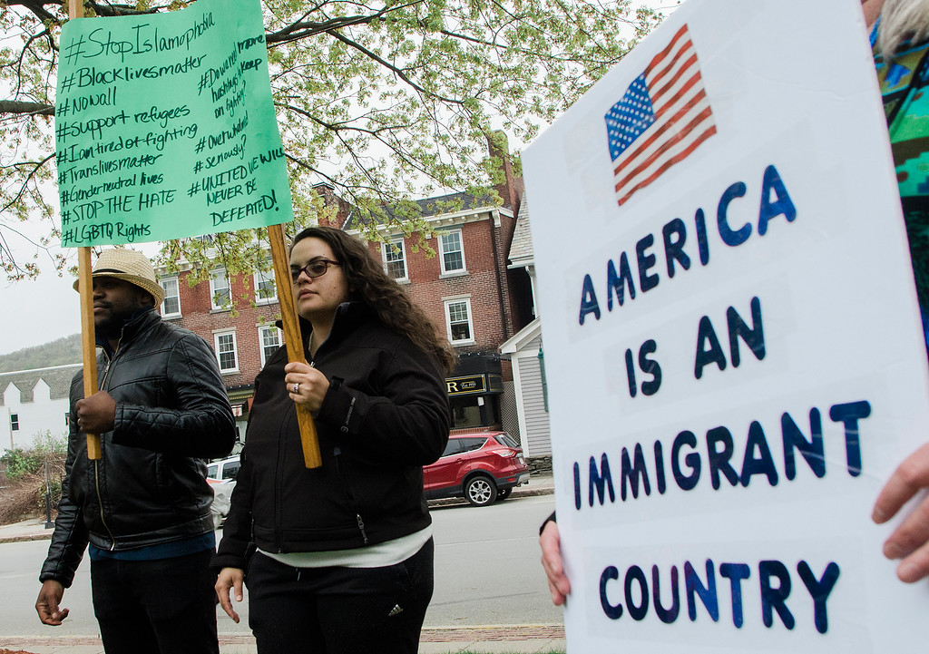 . Osmar Ramos-Cabellero and Cynthia Espinosa joined international protests, marching against immigration policies to mark May Day, or International Workers Day, on Monday, May 1, 2017.SENTINEL & ENTERPRISE / Ashley Green