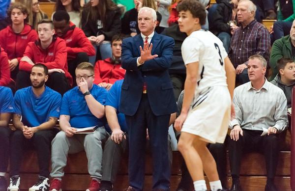 12/27/18 Wesley Bunnell   Staff Newington basketball vs St. Paul on Thursday evening played at Farmington High School. Head Coach Steve Phelps motions to his team.