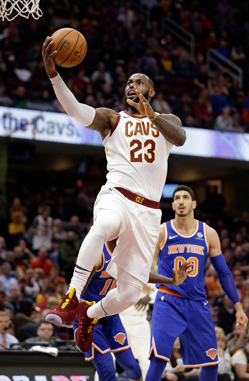 . Cleveland Cavaliers\' LeBron James (23) derives to the basket against the New York Knicks in the first half of an NBA basketball game, Sunday, Oct. 29, 2017, in Cleveland. (AP Photo/Tony Dejak)