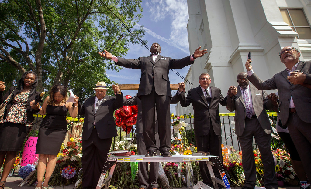 . Dr. Dexter Easley preaches to a crowd gathered outside the Emanuel AME Church during a prayer service by the National Clergy Council, Saturday, June 20, 2015  in Charleston, S.C. Clergy from around the country led prayers and words of hope to the people in attendance. (AP Photo/Stephen B. Morton)