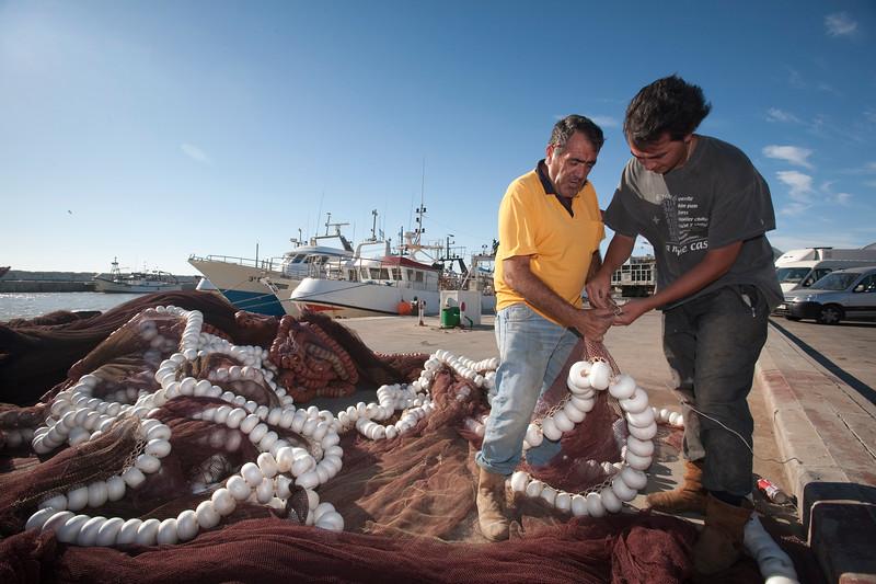 Fishermen fixing the nets. Bonanza port, town of Sanlucar de Barrameda, province of Cadiz, Andalusia, Spain.