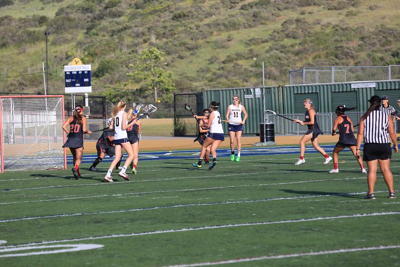 2015_03_31 Girls Lacrosse LCC 15 vs Santa Ana Mater Dei 11 0155.JPG